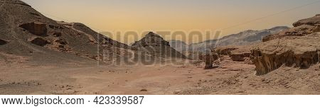 A Panoramic Landscape Of The Timna Valley Desert Park, Israel, Known For Its Unique Rock Formations.