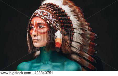 Studio Shot Of Woman Wearing Indian Feather Headwear