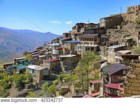 Picturesque Chokh Town With Old Brick Buildings On Hill Steep Slope Among Fantastic Mountains On Sun