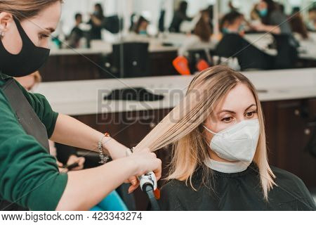 Straightening The Ends Of The Hair By A Hairdresser, Haircut In A Barbershop.