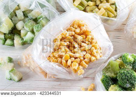 Frozen Corn In Bag On White Wooden Table. Frozen Food
