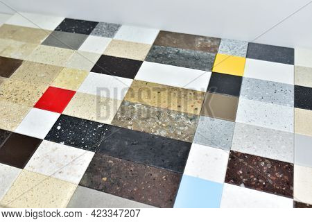 Multicolored Tiles On The Floor. Samples Of Acrylic Artificial Stone For Countertops. Artificial Sto