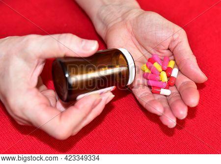 Pills In Capsules In Woomen Hand. Medicine Grade Pharmaceutical Tablets. Medical Pill For Maintainin