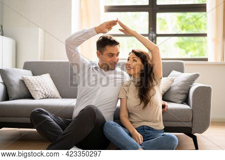 Couple Dreaming And Think To Buy House. Family Plans