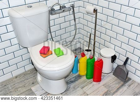 Detergent Bottles And Sponge For Cleaning The Toilet In The Bathroom In Home. Detergents Bottles And