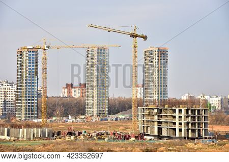 View Of A Large Construction Site. Tower Cranes In Action. Housing Renovation Concept. Crane During