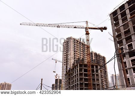 Tower Crane On Construction Of A Residential Building. Cranes On Formworks. Construction The Buildin
