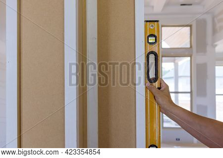 Worker Using Leveling Instrument Check Appropriate Wood Columns Using Level In Under Construction