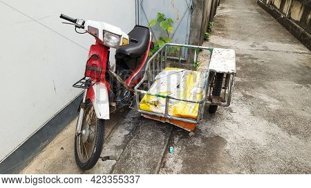 A Traditional Homemade Motorbike With Sidecar Is Parked Near A House Due To The Covid-19 Or Coronavi