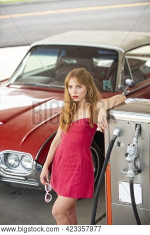 Red Retro Automobile. Old American Car. Gas Station Girl. Woman Refuel The Auto.