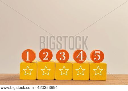 Wooden Blocks With Five Stars And Numbering Icons. Excellent Business Services Rating Customer Satis
