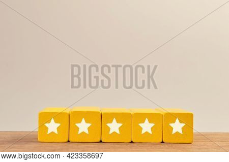 Wooden Blocks With Five Star Icons. Excellent Business Services Rating Customer Satisfaction Concept