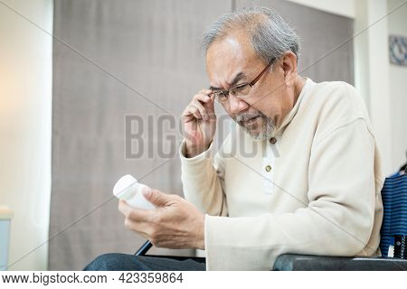 Asian Senior Elderly Male Patient Sit On Wheelchair At Nursing Home Care. Mature Older Disabled Man