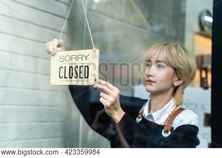 Asian Attractive Beauty Salon Owner Or Hairdresser Turns Welcome We Are Open Sign On Glass Door To R