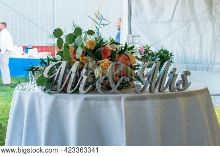 Mr And Mrs Sign At A Wedding Reception