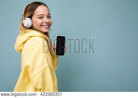 Side-profile Photo Of Attractive Positive Smiling Young Woman Wearing Stylish Casual Outfit Isolated