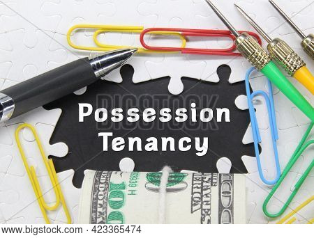 Pen, Arrow, Click, Roll Of Banknote And The Word Possession Tenancy