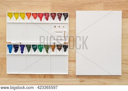 Watercolor Paints Set With White Paper. Multicolored Aquarelle Paints For Art Background.