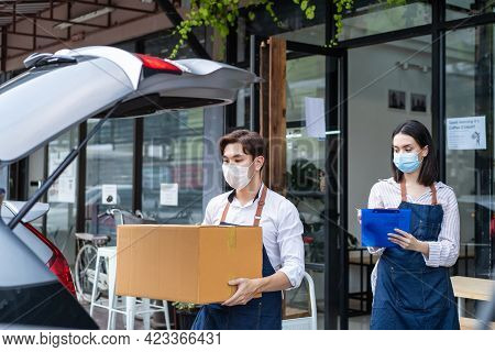 Asian Cafe Business Owner Couple Wear Mask Due To Covid-19 Pandemic, Work In Coffee Shop. Waiter Loa