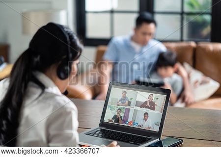 Asian Business Woman Talking To Colleague Team About Plan In Video Conference. Group Of Business Peo
