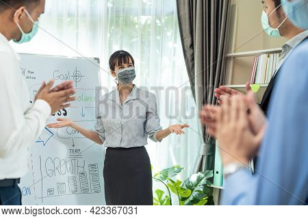 Asian Businesswoman Leader Wear Mask Due To Covid19, Report Work To Colleague Team While Brainstorm