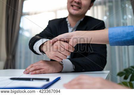 Close Up Hand Of Salesman Banker Handshake With Investor Girl For Loan Insurance Investment After Ne