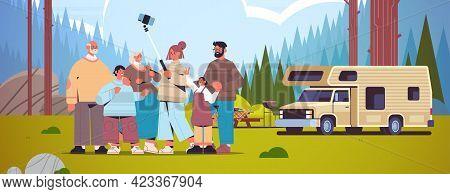 Multigenerational Family Using Selfie Stick And Taking Photo On Smartphone Camera