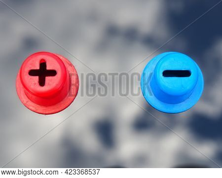 Plus And Minus. Red Positive And Blue Negative Sign. Two Opposite Poles