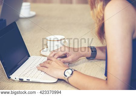 Happy Businesswoman Using Laptop In The Office.woman Working On A Laptop In Cafe.