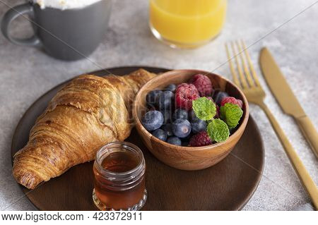 Fresh Croissant, Coffee With Milk, Berries, Syrup And Orange Juice. Continental Breakfast Background