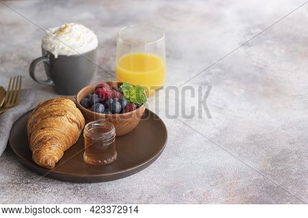 Fresh Croissant, Coffee With Milk, Fruit, Syrup And Orange Juice. Continental Breakfast Background.c