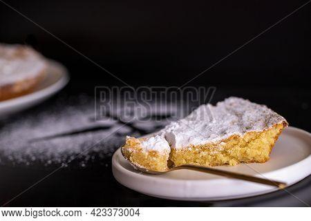 Tarta De Santiago (st. James Cake) Famous Spanish Almond Cake On Black Bacground With  A Silhouette
