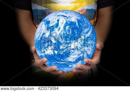 World In Hand Young Generation. Blue Planet On Hand. Save Of Earth. The Concept Of Young Children Ta
