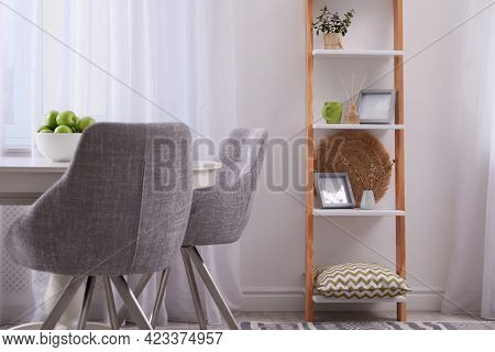 Stylish Living Room Interior With Wooden Ladder Near White Wall