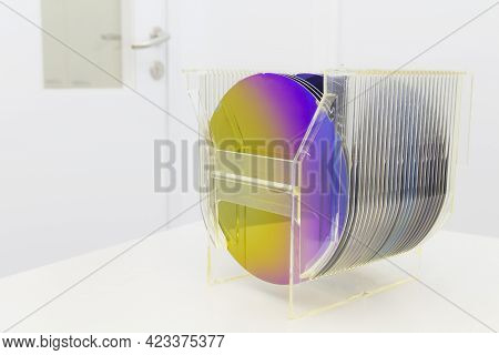 Silicon Wafers In Plastic Storage Box In Clear Room Of Semiconductor Foundry.