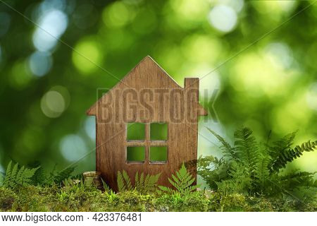 Eco Friendly Home. House Model On Green Grass Outdoors