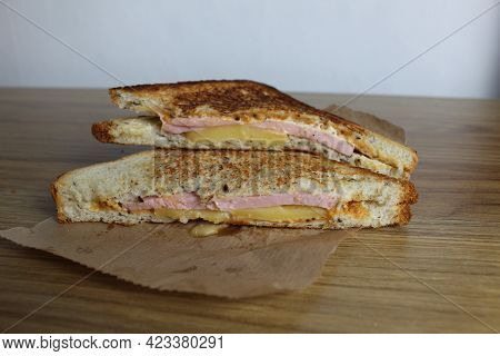 Food, Avtrak. Sandwiches With Ham Cheese And Vegetable Elenium Lie On A Gray Plate Next To The Juice