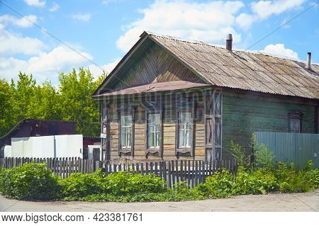 Old Abandoned Rustic Wooden House With Three Windows On The Facade