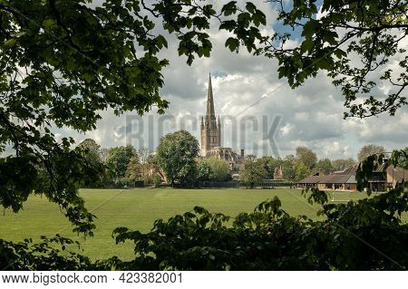 Norwich Cathedral Framed By Green Tree Branches