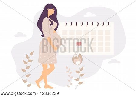 The Happy Pregnant Girl Looks At The Calendar. Beautiful Cute Woman Hugs Her Belly And Stands By The