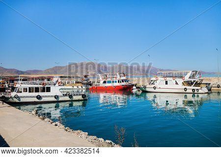 Tourist Boats In Bay Near Akdamar Island On Van Lake, Gevaş, Turkey. Bright Blue Colour Of Water Is