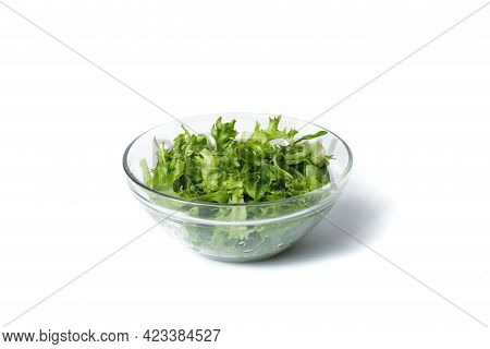 Fresh Arugula In A Plate. Vegan Food Concept. Transparent Plate With Arugula. Isolated On White.