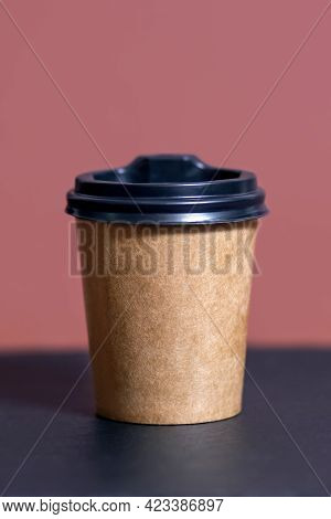 Disposable Coffee Cup For Cafe On A Bar Table. A Brown Cardboard Mockup Of An Environmentally Friend