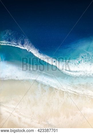 Top View On Sea Wave With White Foam And Light Beige Sand. Drawing With Epoxy Resin. Close-up Of Dee