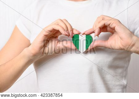 Flag Of Nigeria In The Shape Of A Heart In The Hands Of A Girl. Love Nigeria. Respect For The People