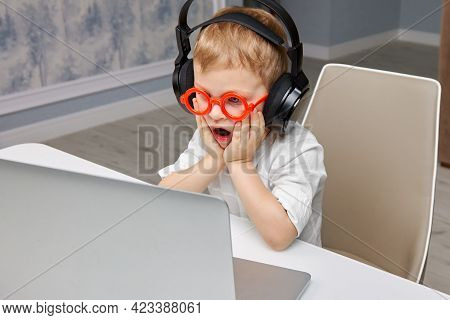 Boy In Red Glasses Clutched His Face, He Is Shocked And Surprised By What He Saw On The Internet Fro