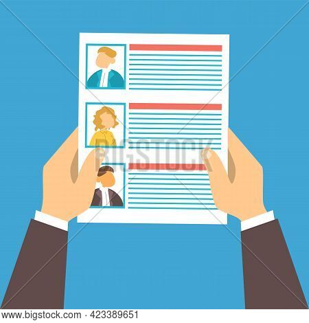 Hand Holding Paper Sheet With List Of Candidates