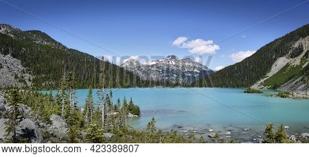A Beautiful Glacial Lake In Canada. The Turquoise Joffre Lake Is Surrounded By The Rainforest. Mount