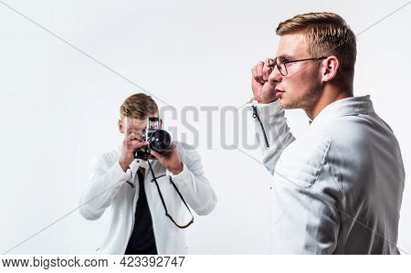Two Cousin With Retro Photo Camera. Young Confident Brothers. Confident Model Photographer