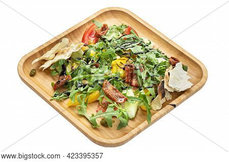 Vegetable Salad. Salad With Arugula And Tomatoes In A Wooden Plate Isolated On White Background. Fil